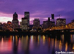Downtown Portland at night with the lights reflecting on Willamette River